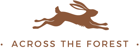 Across the Forest Wedding Photographer logo brown bunny